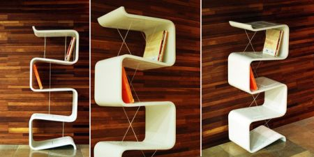 Ready for a modern note in your living room? These bookshelves look like a  snake crawling on your walls. Guess what they have swallowed? Check this  out!