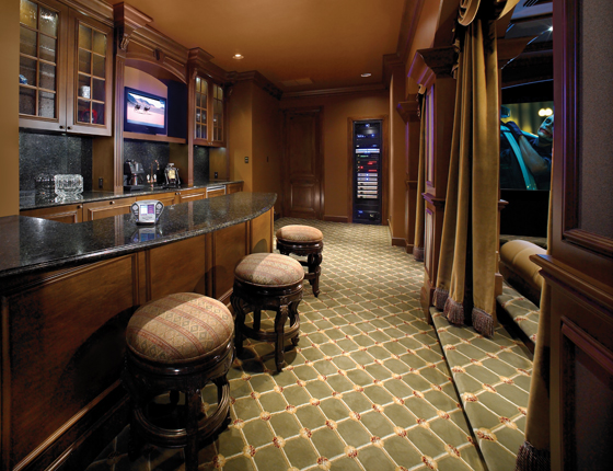 Home theater with a bar counter to raise a toast