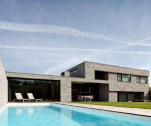 Modern black and white residence in the Netherlands features a stone exterior