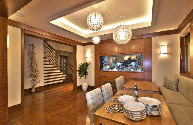open space dining room with a built in aquarium