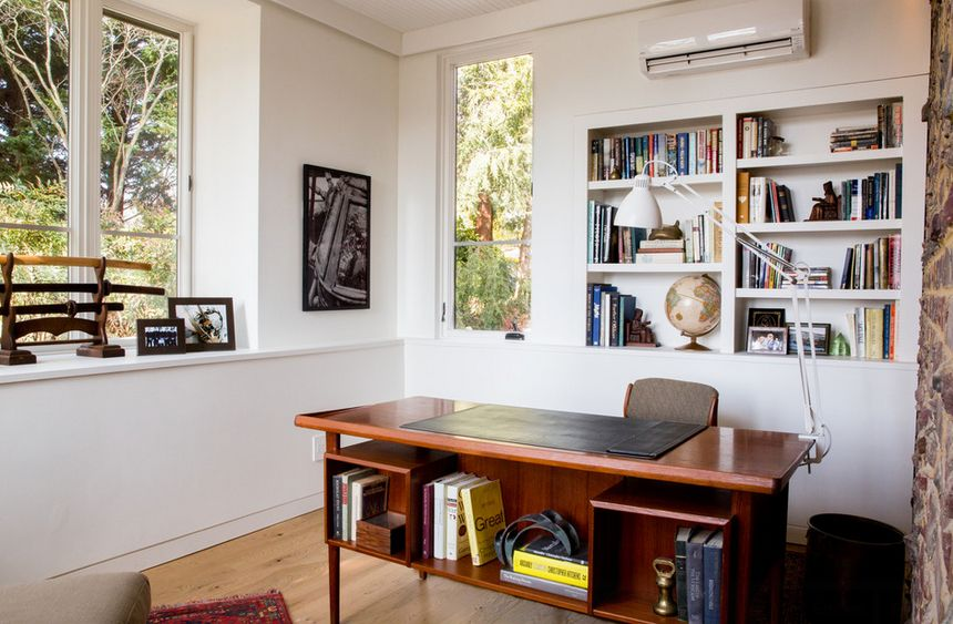 Office room featuring a stone wall