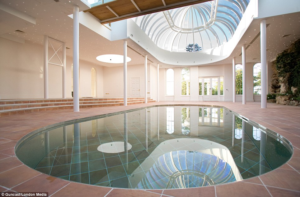 A Swimming Pool That Disappears Under Its Own Floor