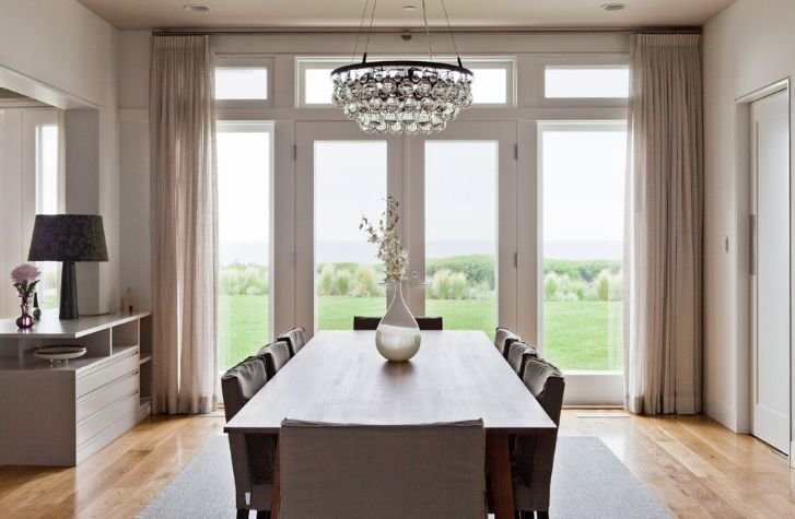 How to choose a chandelier for your dining room glass chandelier above the dining table aloadofball Image collections