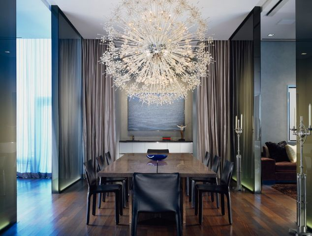 Large Chandelier Above The Dining Table For A Modern Look