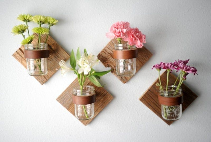 Mason jars on wall flowers