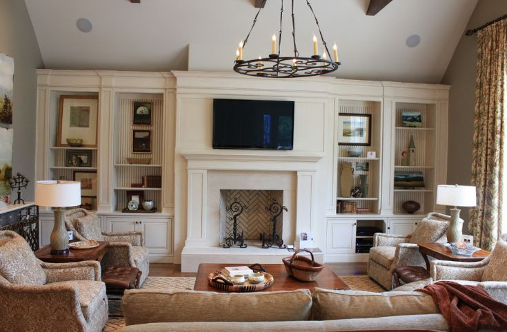 Living room with chandelier and tv on wall