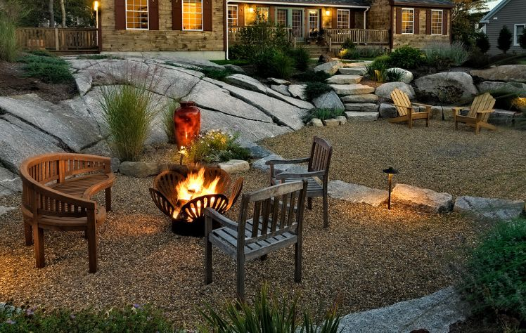 Metalic outdoor firepit with a design