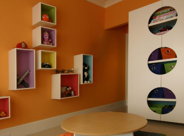 Orange wall paint and vertical storage