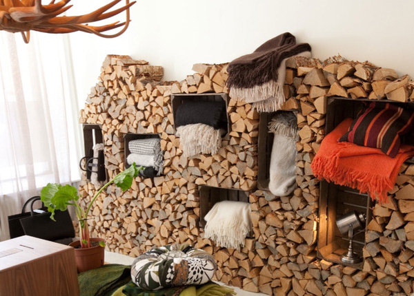 A rustic indoor firewood storage idea for Log storage ideas