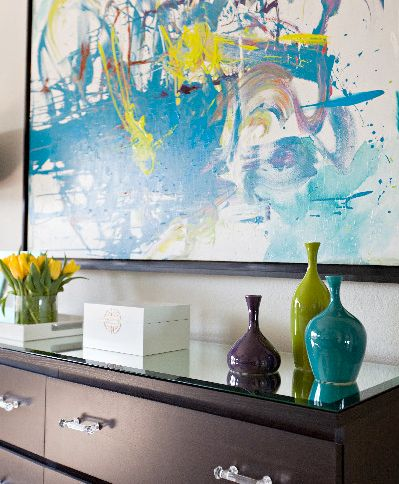 Abstract wall art and colorful vases