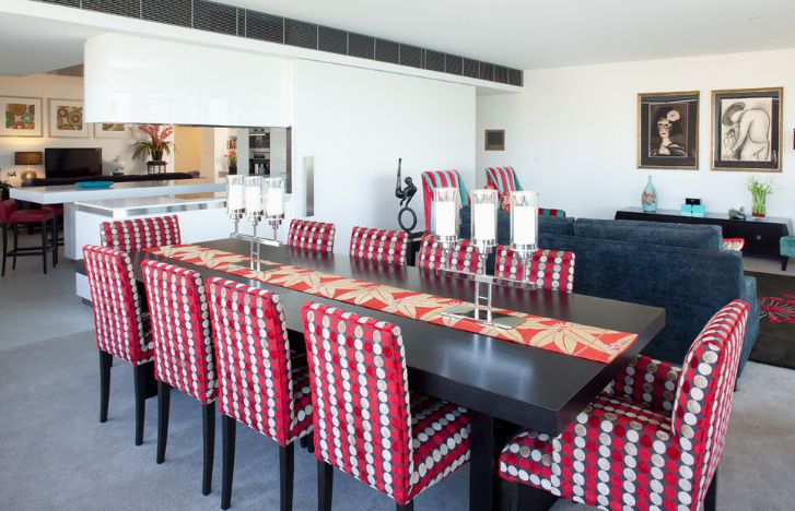 Black dining table with red armchairs