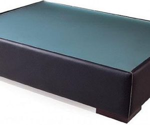 Modern leather coffee table with glass top and wooden legs