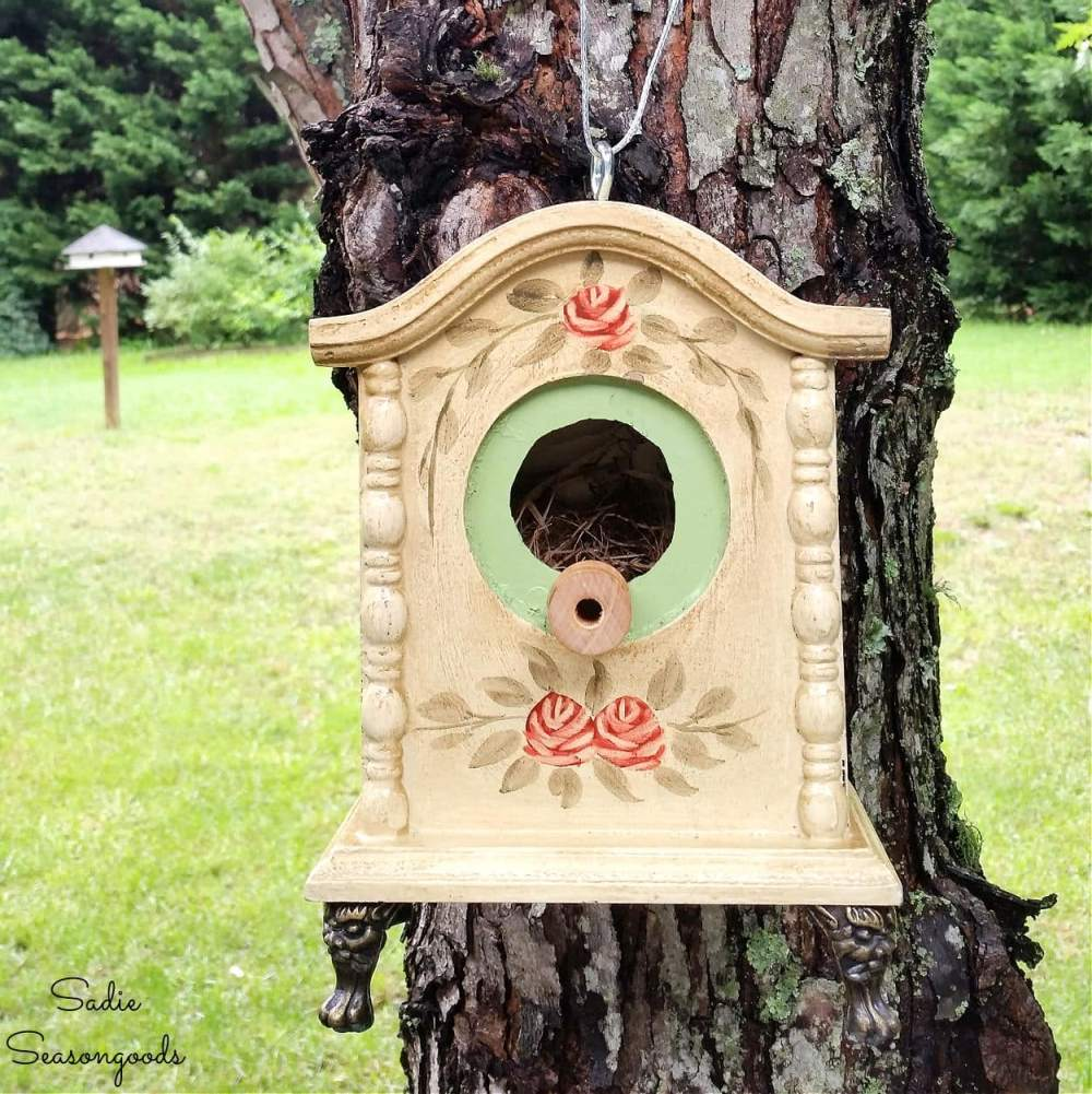 A birdhouse made from an old clock