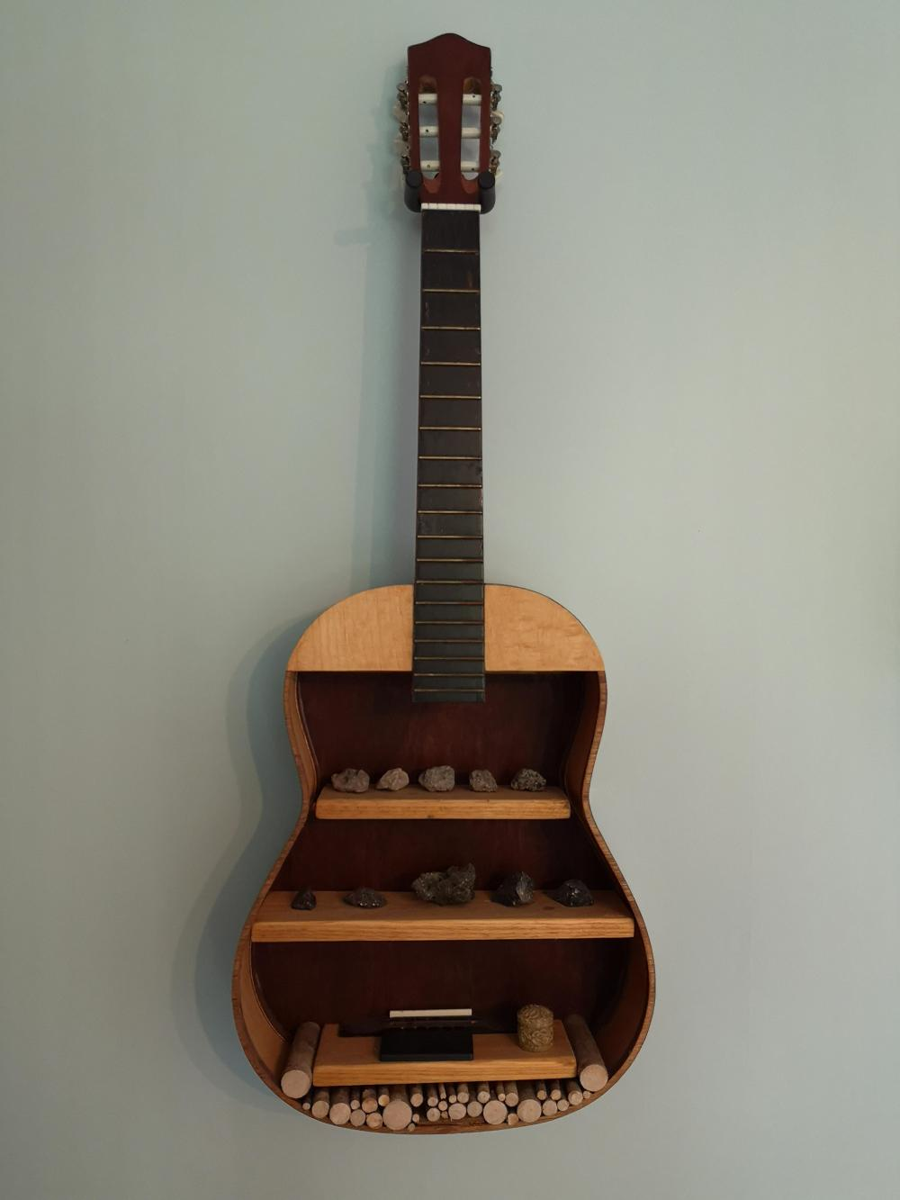 An old guitar full of Rock & Roll