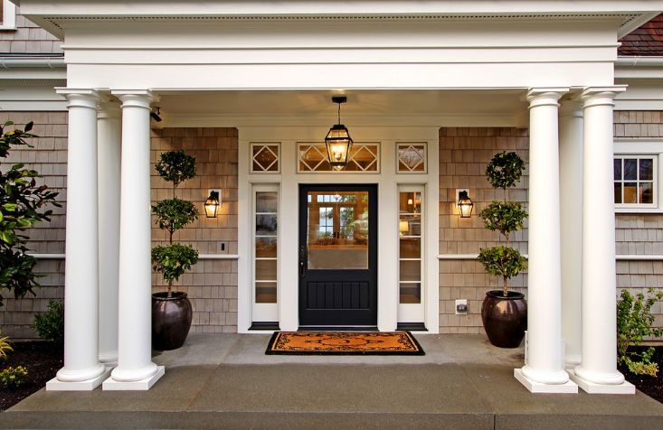 Large columns for entryway and black door