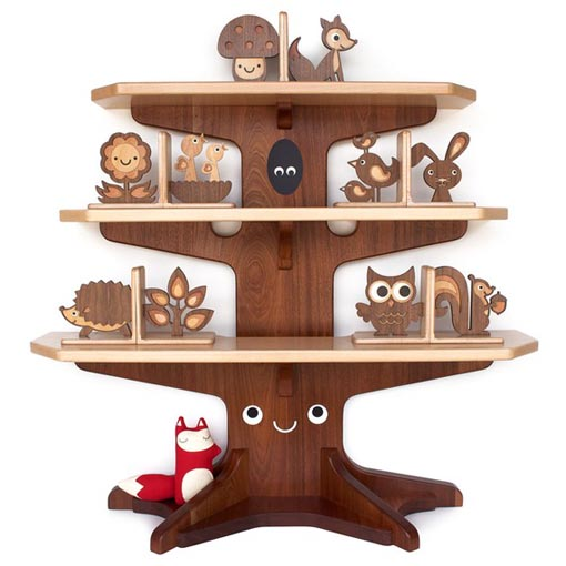 Funny looking objects and toys sit next to bright colored books. See our  site for a funny bookshelf that looks like ...