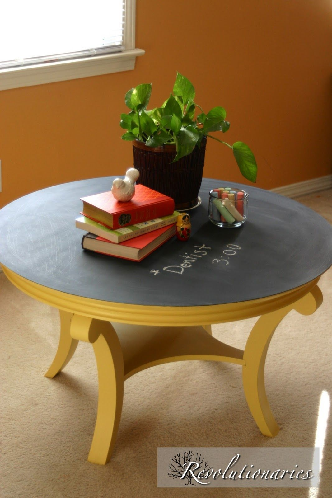 Round coffee table with chalkboard on top