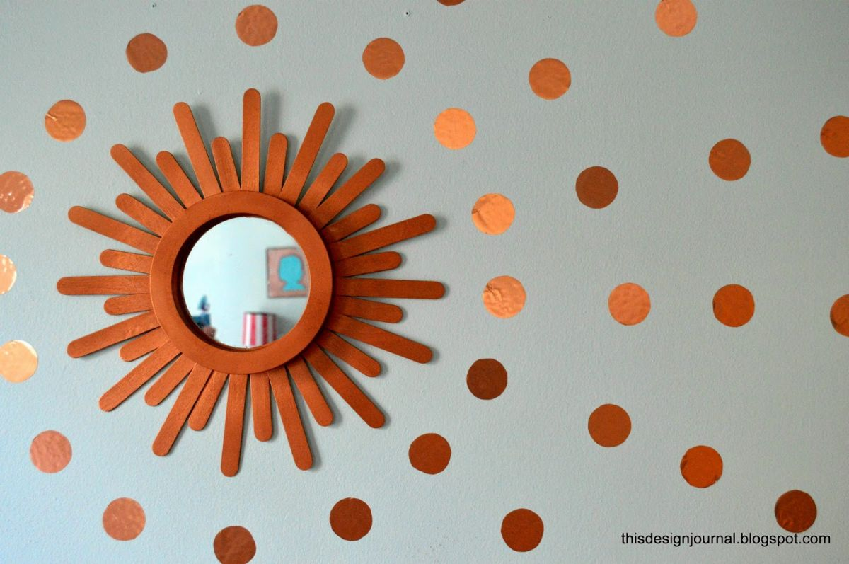 Wood craft sticks to create a sunburst mirror