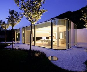 Lake Lugano house – an unusual glass structure by JM Architecture