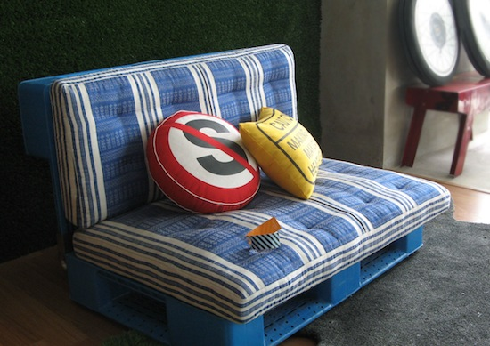 Small couch made from shipping pallets