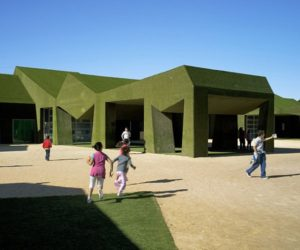 Playful school design covered in grass
