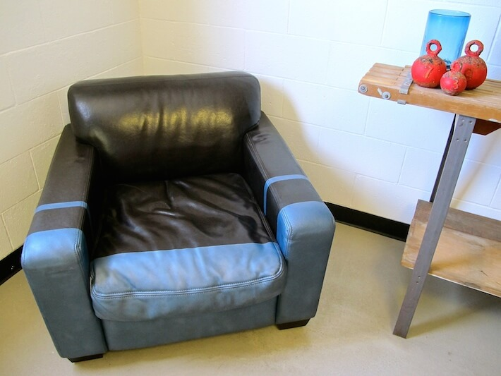 Dipped leather armchair