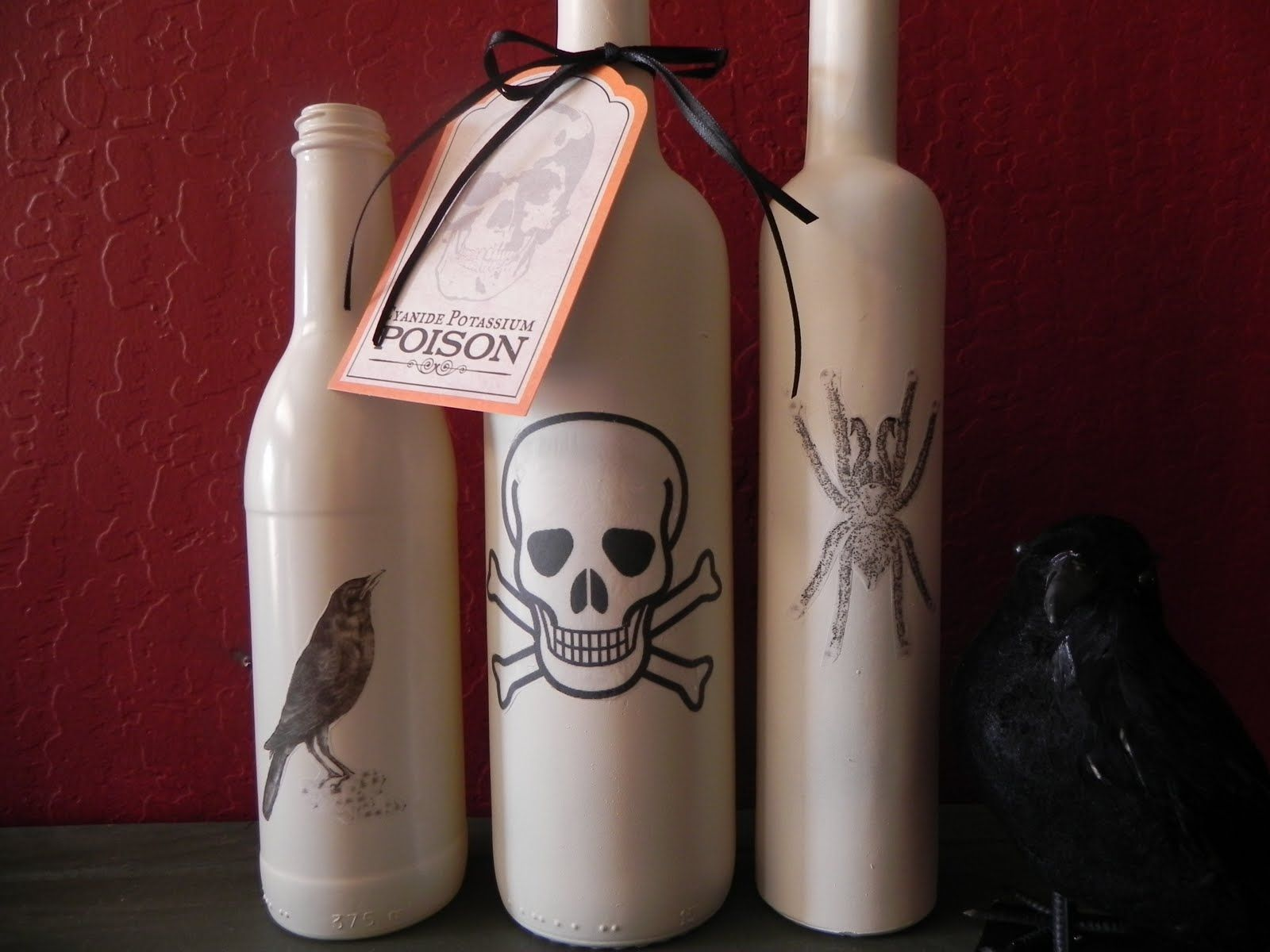 Wine bottles decorated for Halloween Closer