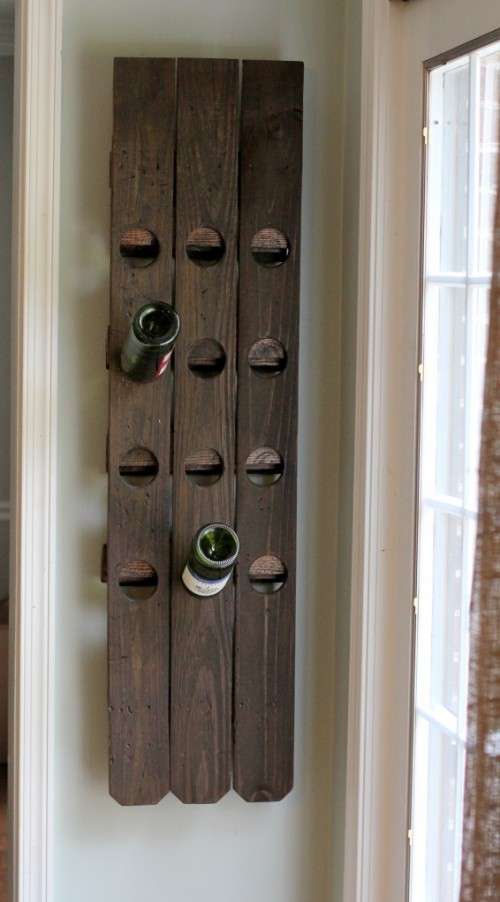 diy-wall-mount-riddling-wine-rack-from-a-fence-1-500x902