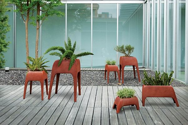 Interesting Safari Planters by Kenneth Cobonque