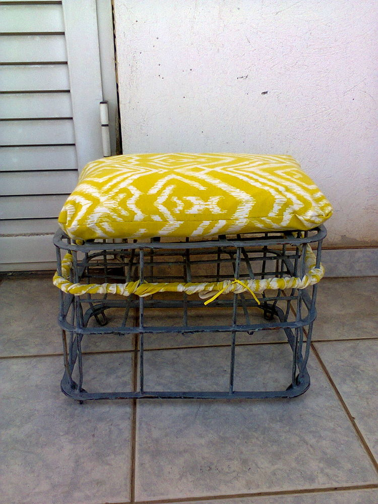 Repurposed milk crate into a stool