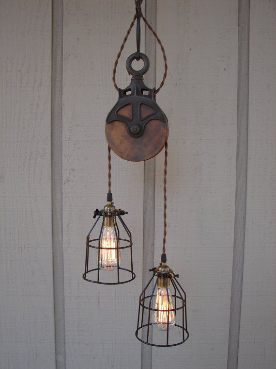 8 original industrial pendant lights you can craft yourself upcycled farm pulley lighting pendant with bulb cages aloadofball Image collections