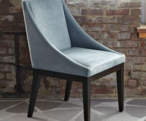 Classic upholstered chair with a delicate silhouette