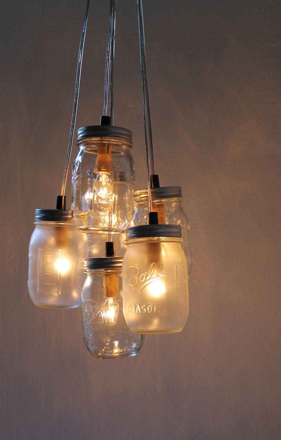 How to upcycle mason jars into a chandelier hanging mason jar lighting fixture arubaitofo Image collections