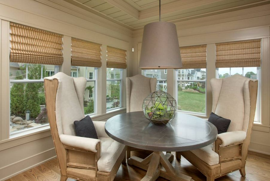 Sunroom round dining table with a top terrarium globe
