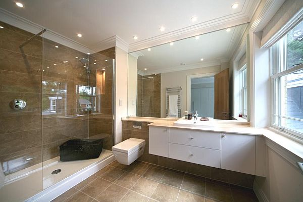 The modern surrey villa in england with an impressive tv room for Ensuite dressing room ideas