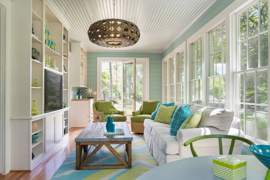 Modern then a colorful and invinting sun room