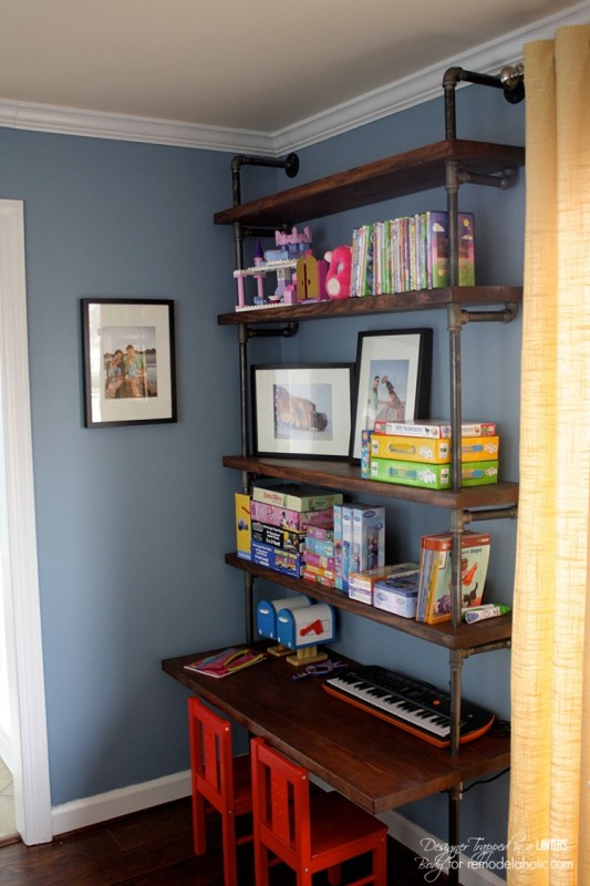 Pipes shelving system with desk area closer to window
