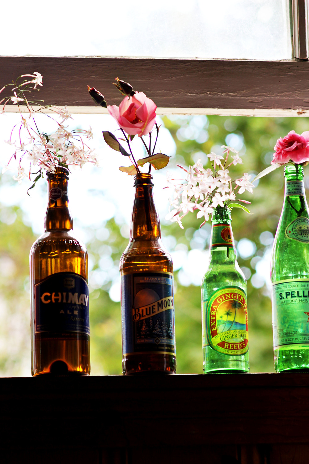 Recycle old bottles and turn them into flower vases