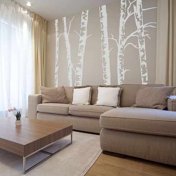birch wallpaper behind sofa