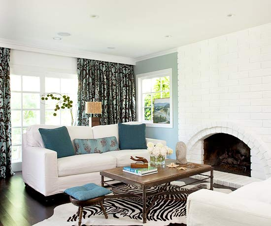 A Very Pale Blue Accent Wall With Small Turquoise Accents The