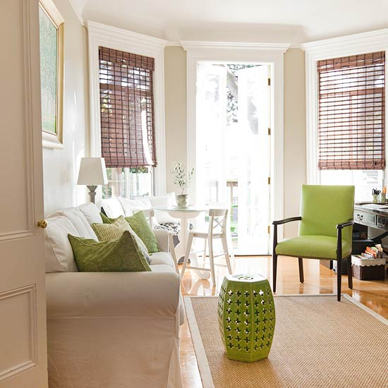 A Rather Neutral Living Room Dcor Featuring Bursts Of Green
