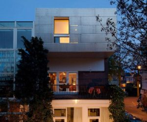 A corner house with a perforated aluminum facade