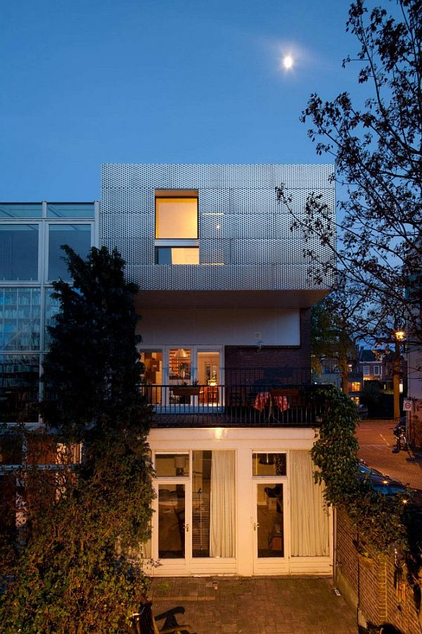 Charming A Corner House With A Perforated Aluminum Facade Design Inspirations