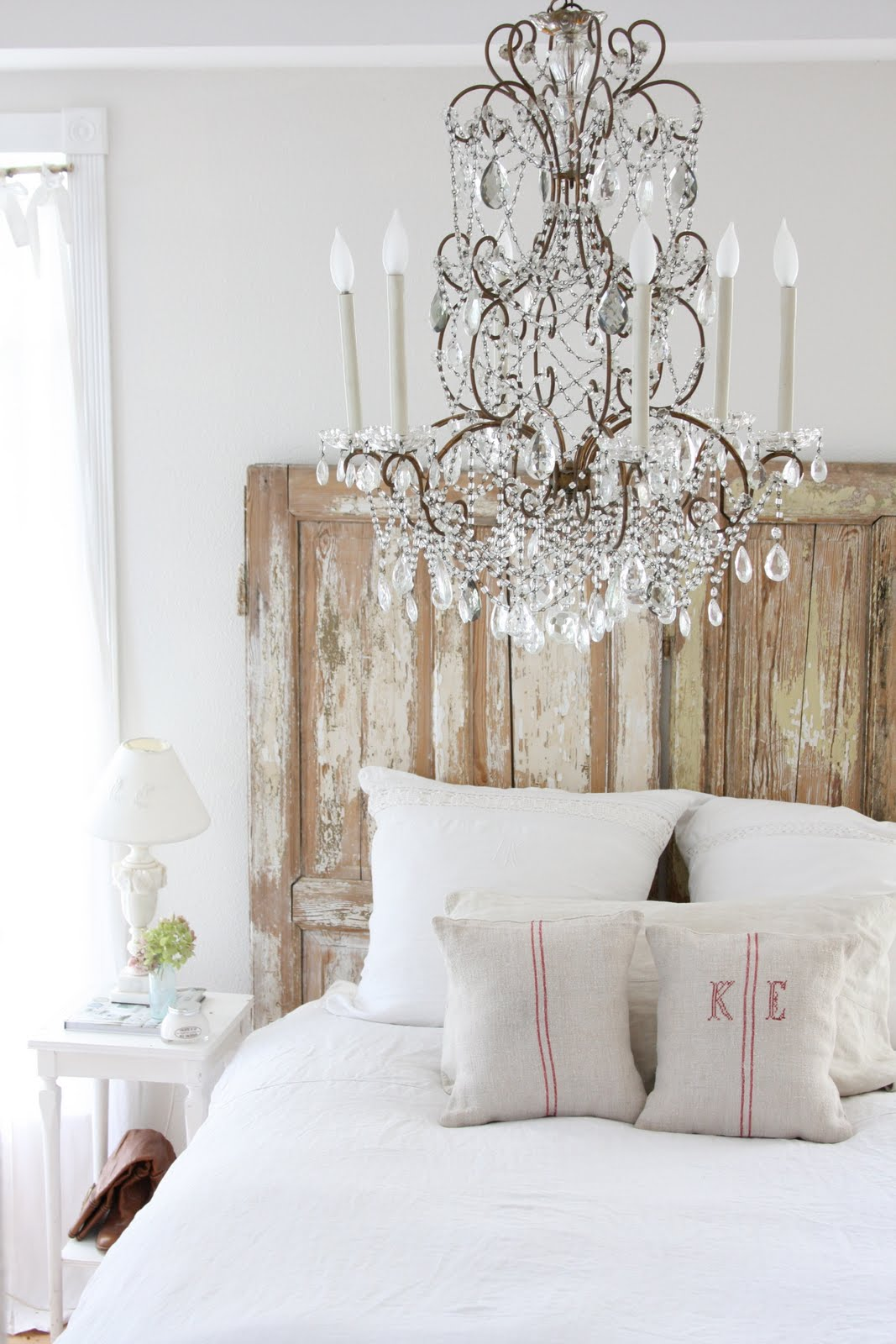 Old Door Headboard Chandelier Over The Bed