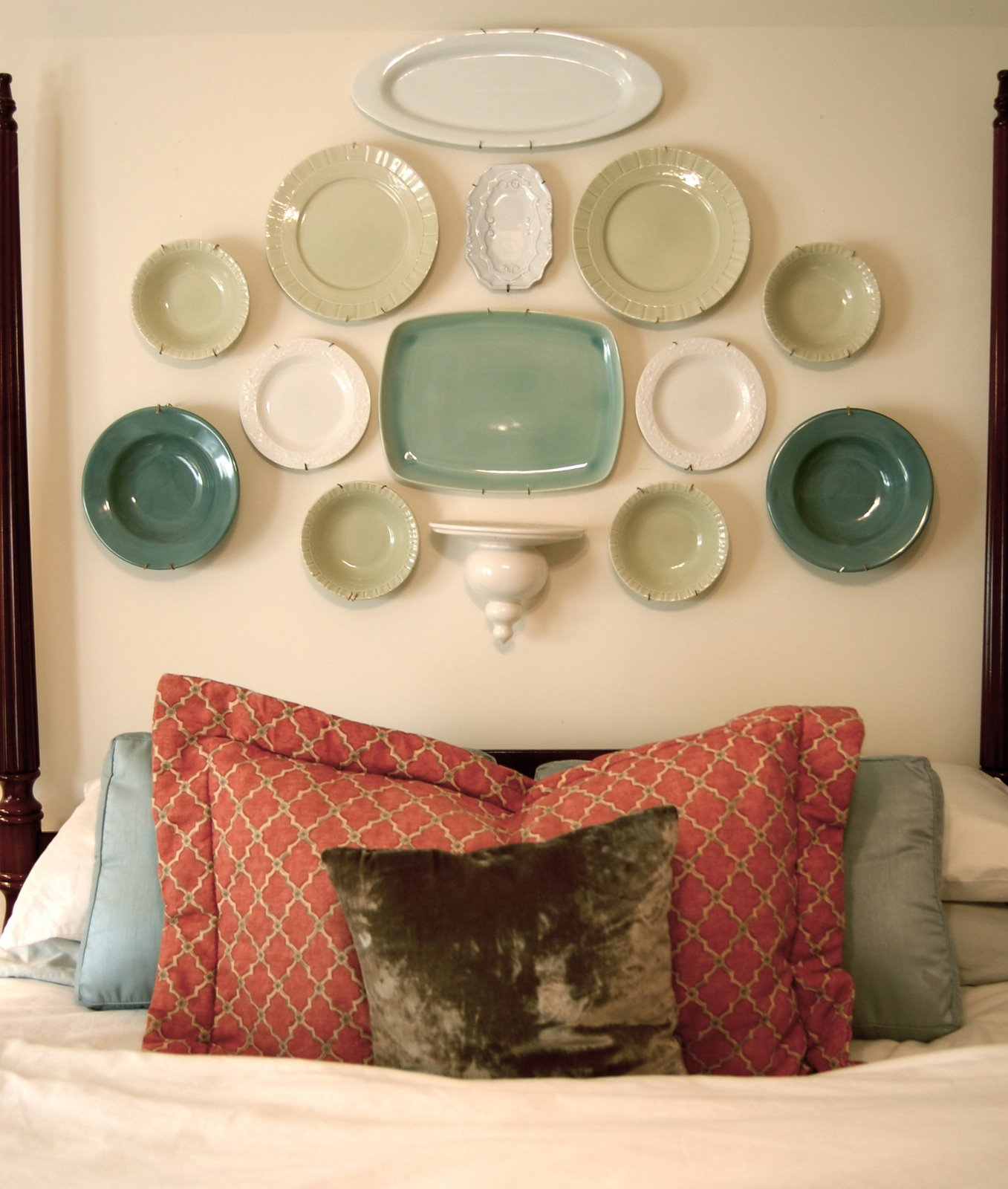 Hang plates above the bed like headboard