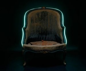 The antique Bérgere chair adorned with a turquoise neon & Retro-chic Louisa Bergere Chair