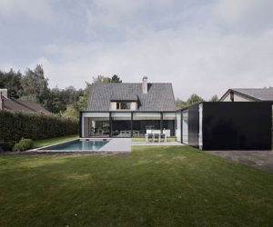 House DS – a contrasting residence at the limit between old and new