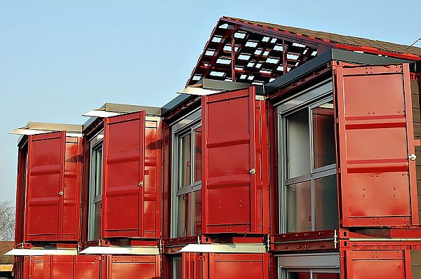 A two story house made of eight shipping containers with a modern interior design - Bithcin shipping container house ii ...