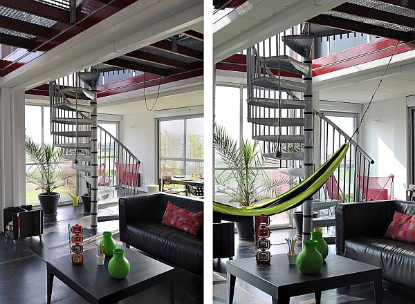 A two story house made of eight shipping containers with a ...