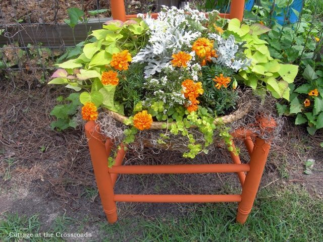 Orange chair turned into a planter